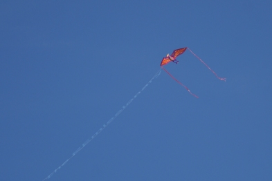 high-flying orange kite